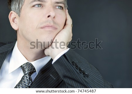 Close-up of a confident businessman gazing off camera. - stock photo