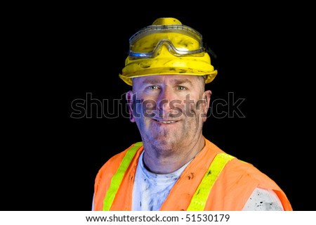 Close up of a construction utility worker wearing protective workwear to emphasize safety. - stock photo