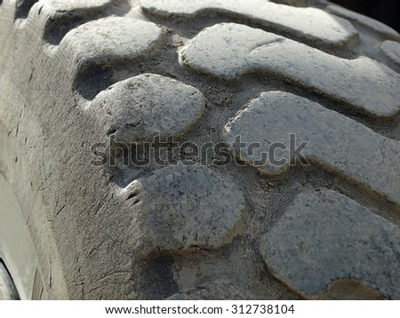 Close Up of a Construction Vehicles Tires Treads - stock photo