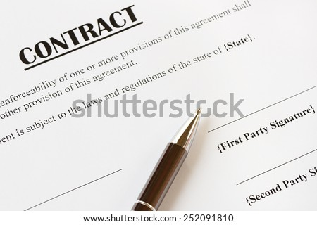 Close up of a contract ready to be signed.With pen.Office,legal concept.