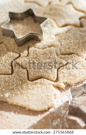 close up of a cookie cutter and a cake dough