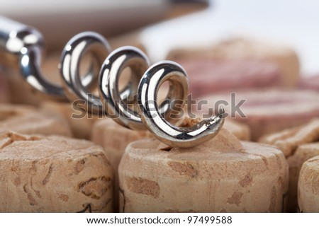 Close up of a corkscrew spiral lying on cork