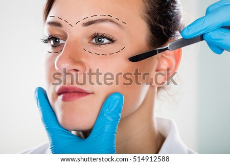 Close-up Of A Cosmetic Face Surgery With Scalpel