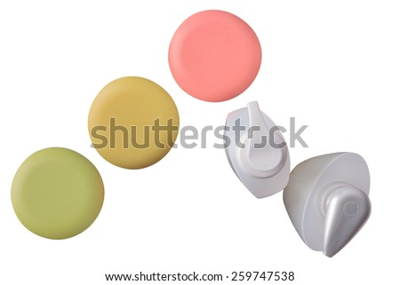 close up of a cosmetics white bottles plastic on white background bottle and soap-dish with soap amid plastic containers for cosmetics - stock photo