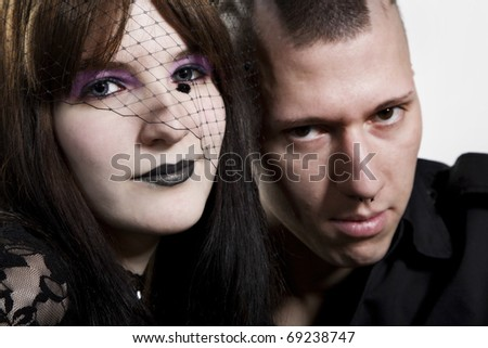 Close-up of a couple punk on white background - stock photo