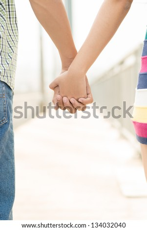 Close-up of a couple's hands together - stock photo