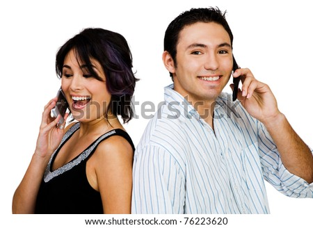 Close-up of a couple talking on mobile phones isolated over white