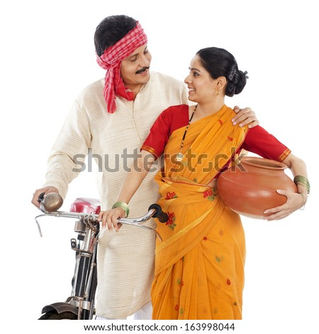 Close-up of a couple with bicycle - stock photo