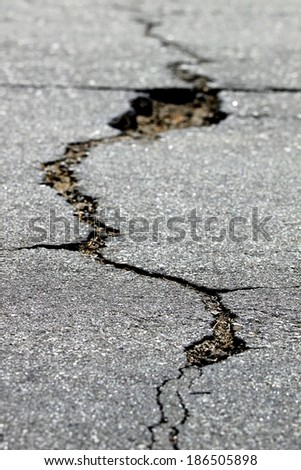close up of a crack in the street - stock photo