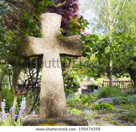 Close-up of a cross in a cemetery - stock photo