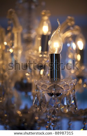Close-up of a crystal chandelier, selective focus and intentional blur.