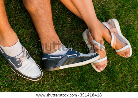 Close up of a cuddling couple legs. Feeling safe and comfortable near him. - stock photo