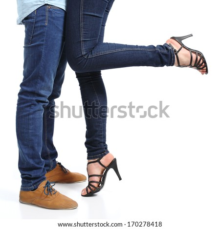 Close up of a cuddling couple legs isolated on a white background              - stock photo