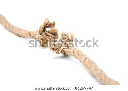 Close up of a damaged rope on white background - stock photo