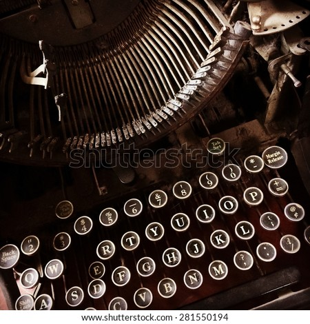 Close-up of a dark and rusty vintage typewriter. - stock photo