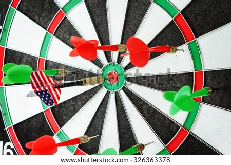 Close-up of a dart with american flag in a bullseye