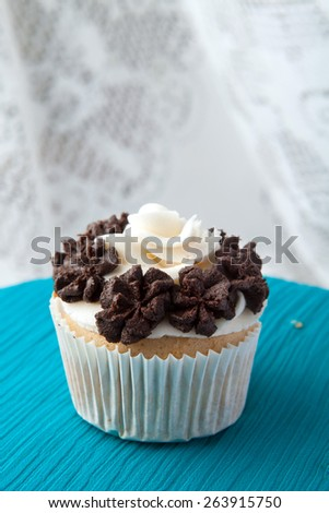 Close up of a decadent gourmet cupcake with chocolate and vanilla frosting.  - stock photo