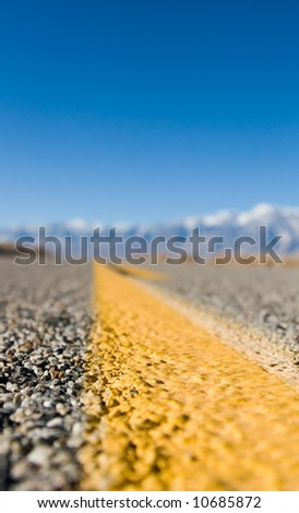 Close up of a desert highway lane marker - stock photo