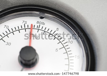 Close-up of a dial from a set of scales showing imperial and metric units - stock photo