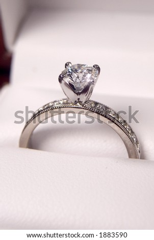 close up of a diamond engagement ring in the box - stock photo
