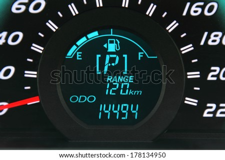Close-up of a digital car fuel gauge - stock photo