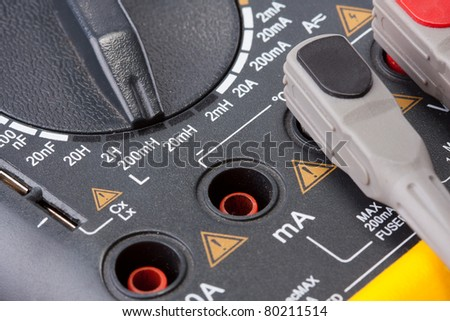 Close-up of a digital multimeter measurement sockets - stock photo