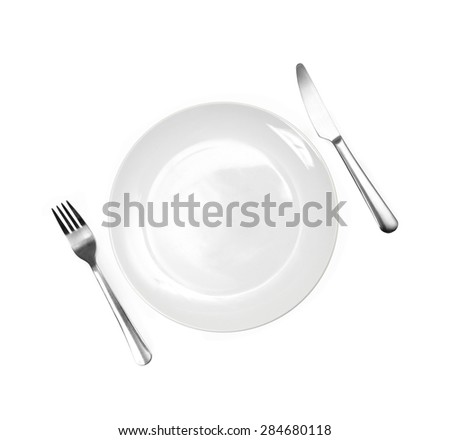 Close up of a diner plate with fork and spoon - stock photo