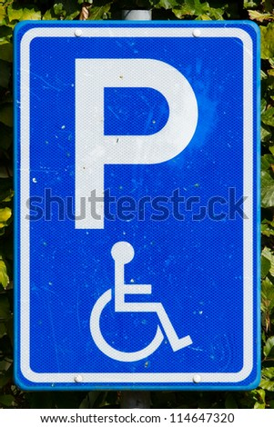 Close-up of a dirty parking sign for disable people