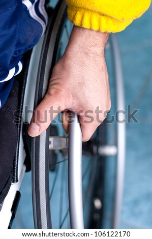 close up of a disabled young man in wheelchair - stock photo