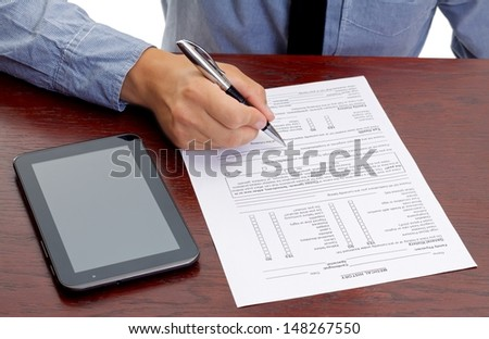 Close up of a doctor who is signing the medical record