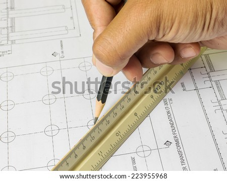 Close Up Of A Draftsman Drawing On Blueprints - stock photo
