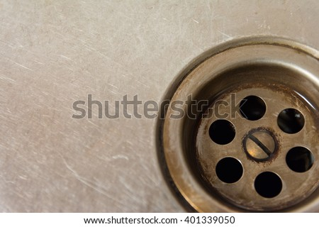 Close up of a drain hole in a dirty sink - stock photo