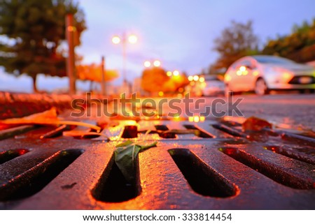 close up of a drainage sewer at sunset - stock photo