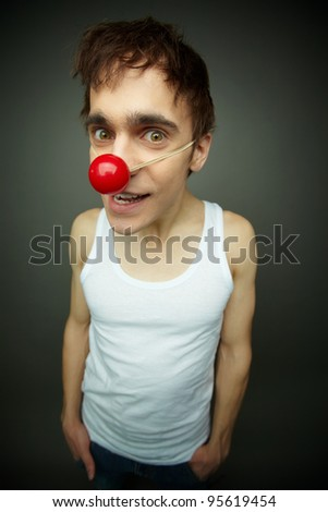 Close-up of a dude with a maniac look celebrating fool�s day - stock photo
