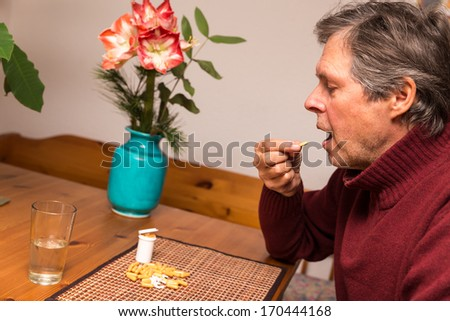 close up of a elderly man with pills - stock photo