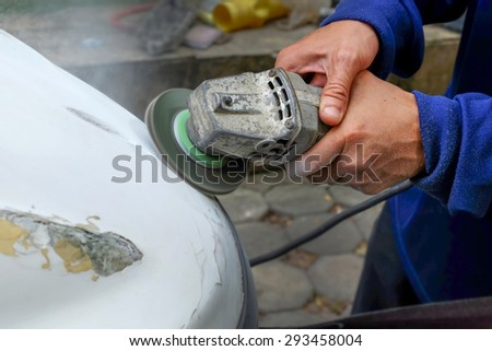 Close-up of a electric grinder to smooth the surface  - stock photo