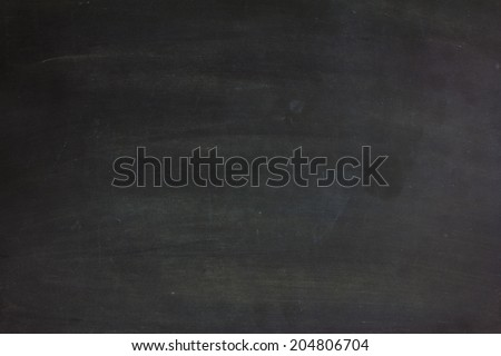 close up of a empty black dirty chalkboard  - stock photo