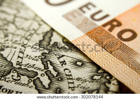 Close-up of a 50-euro banknote and an old map of Greece - stock photo