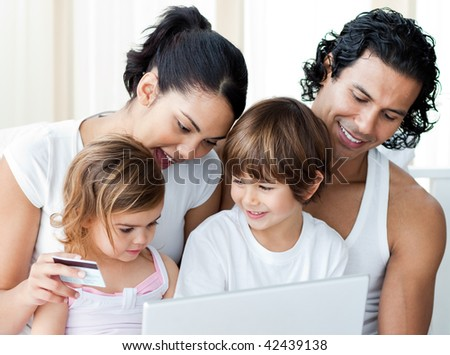 Close-up of a family shopping online at home - stock photo