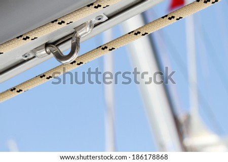 Close-up of a fasten rope. Details yacht - stock photo