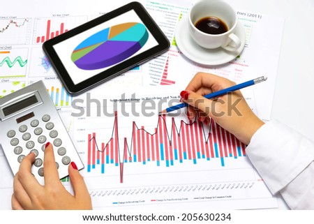 Close up of a female hands, doing business statistics, at office desk.  - stock photo