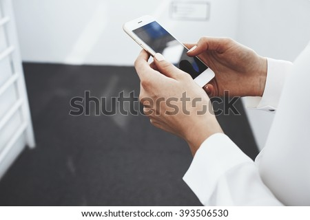 Close up of a female lawyer is typing on mobile phone text message with new good news for her client. Woman smart office worker is searching information for conference on website via cell telephone - stock photo