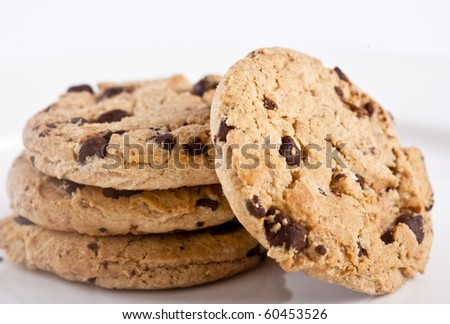 Close-up of a few Chocolate chip cookies over a White Plate - stock photo
