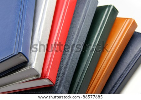 Close-up of a few colored books (notebooks, diaries).