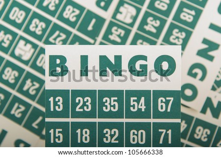 Close-up of a few green bingo cards