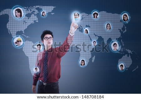 Close-up of a finger clicking on digital social network on blue background   - stock photo