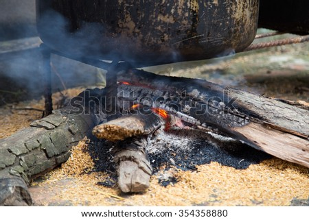 Close up of a firewood cooker, traditional cooking - stock photo