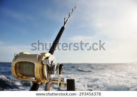 Close-up of a fishing reel on the boat - stock photo