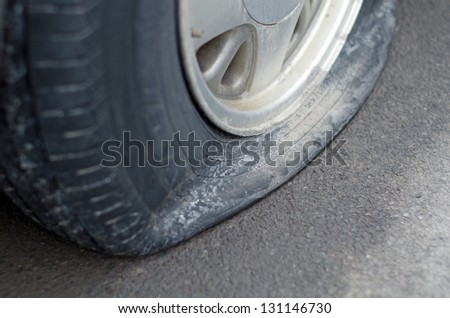 Close up of a flat tire on car - stock photo
