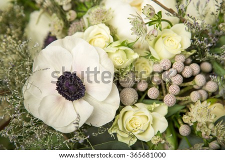 Close-up of a flower arrangement with white anemones, roses and peonies - stock photo